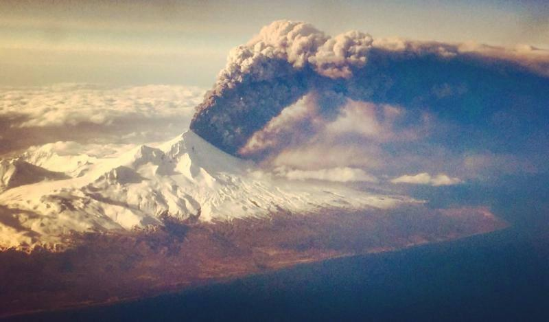 Pavlof volcano in eruption, March 27, 2016. (Photo courtesy of Colt Snapp, taken from a flight enroute to Anchorage, from Dutch Harbor)