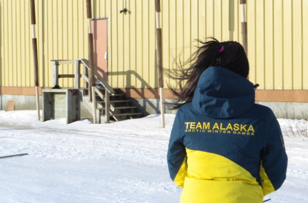 A woman in a blue and yellow puffy jacket