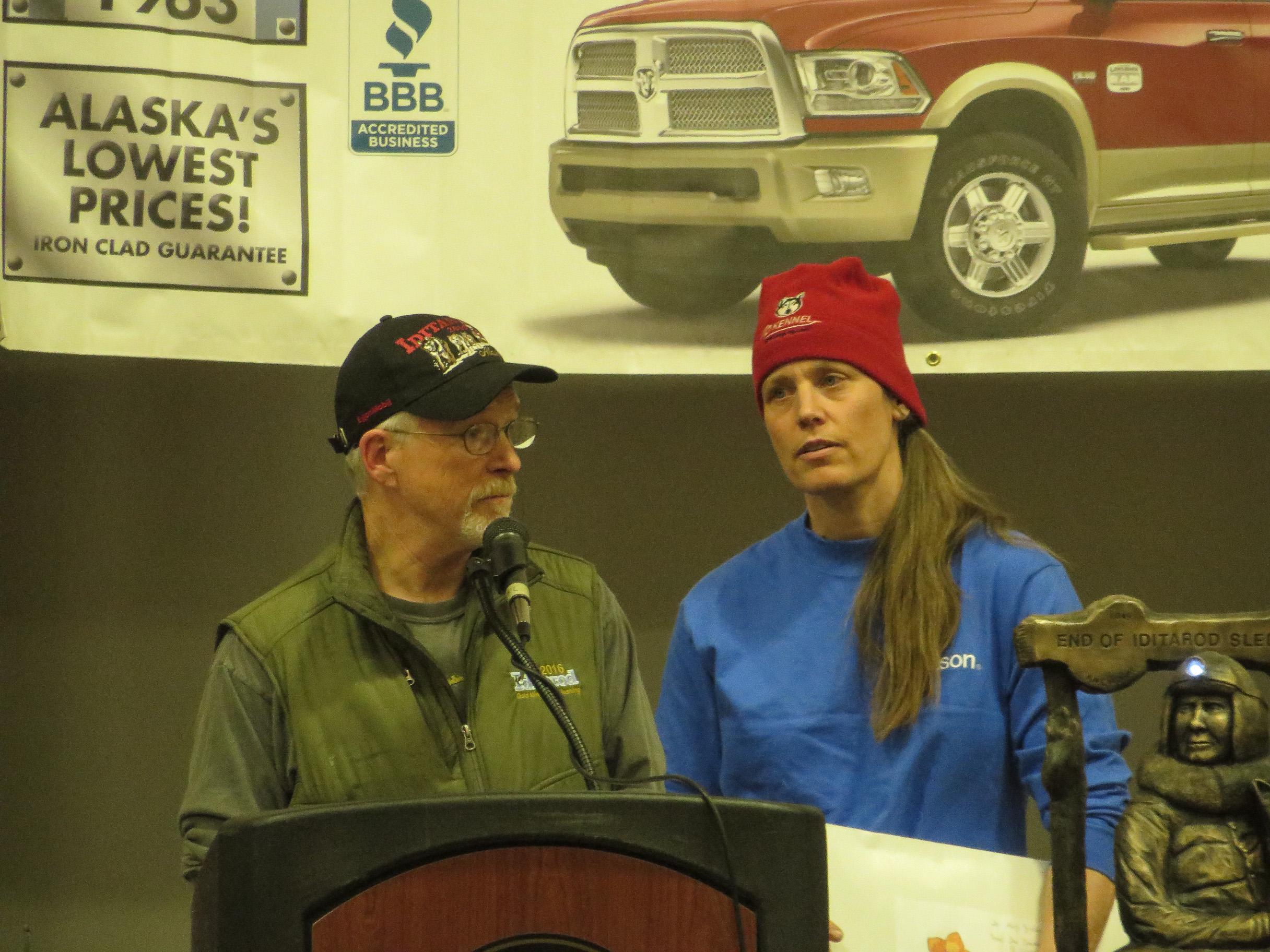 Jeff King and Aliy Zirkle thank the community of Nulato at the Iditarod Banquet Sunday night. The checkpoint village raised money for the mushers after a drunk snowmachiner struck their teams on the trail. (Photo by Laura Kraegel, KNOM - Nome)
