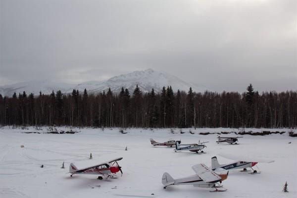 Bush planes parked Wednesday on the river near the Takotna checkpoint. (Photo by Zachariah Hughes, Alaska Public Media)