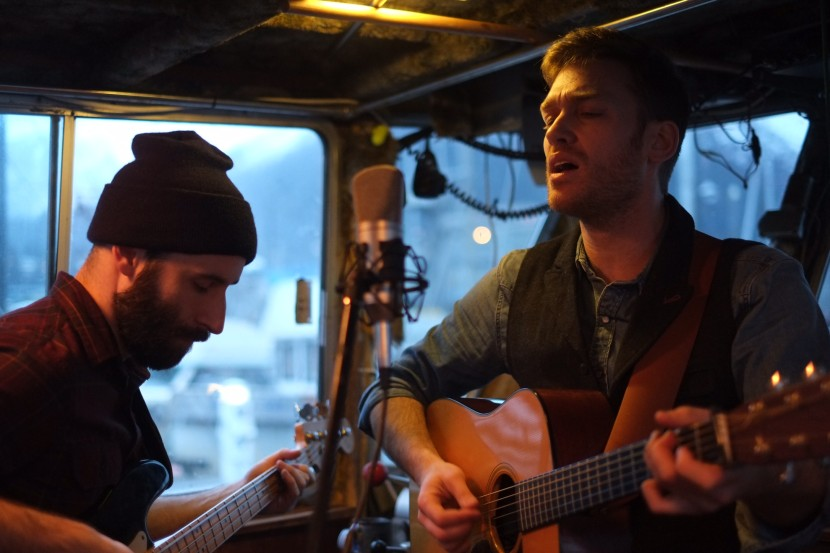 Dan DeSloover and Dan Kirkwood perform on the F/V Arete as part of their Tiny Desk Contest submission. (Photo by Annie Bartholomew, KTOO - Juneau)