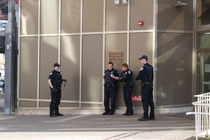 Juneau police outside the Dimond Courthouse, where a woman died from a gunshot wound in an apparent suicide. (Photo by Elizabeth Jenkins/KTOO)