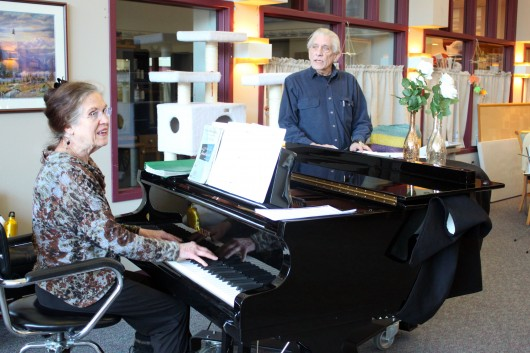 Jacque Farnsworth and Jack Brandt lead a music activity at the Juneau Pioneers' Home. Farnsworth says she's been singing and playing piano there since 2003. (Photo by Lisa Phu, KTOO - Juneau)