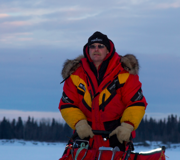 Two-time champion Mitch Seavey, pictured here in McGrath, is taking his 24-hour break in Takotna. (Photo by Zach Hughes, Alaska Public Media)