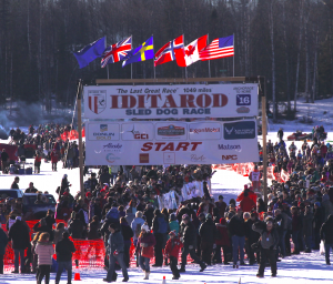 Iditarod officials are adjusting Robert Redington's race schedule after he was mistakenly released early from Nikolai. (Photo of Iditarod restart by Ben Matheson/Alaska Public Media)