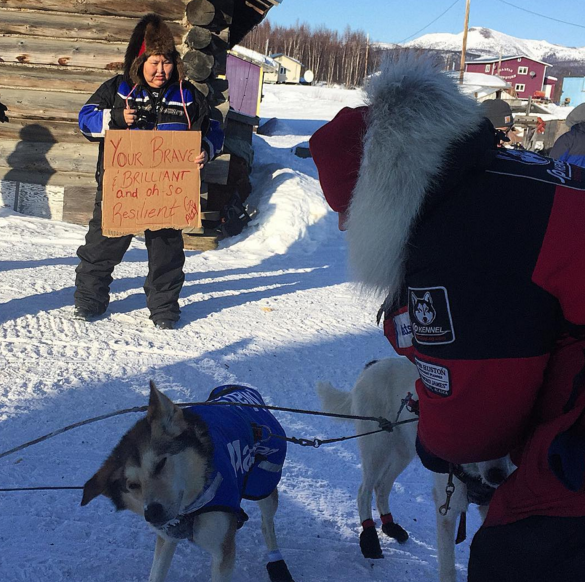 """""""You're brave & brilliant & oh so, resilient"""" reads a handmade sign from Anne Neglaska in Kaltag. Aliy Zirkle was attacked overnight by a snowmachiner. (Photo by Emily Schwing/KNOM)"""