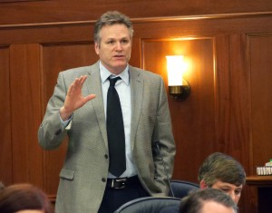Sen. Mike Dunleavy, R-Wasilla, on the floor of the Senate during debate about the state operating budget, March 14, 2016. (Photo by Skip Gray/360 North)