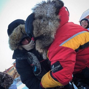 Dallas (left) and Mitch (right) embrace and share a few words before departing Koyuk. (Photo by Emily Schwing/KNOM)