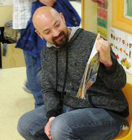 Pat Stack reads a story to kids at the PeaceHealth Ketchikan child care center, run out of Holy Name School. Stack recently was named the top child care administrator in Alaska. (Photo by Leila Kheiry, KRBD - Ketchikan)