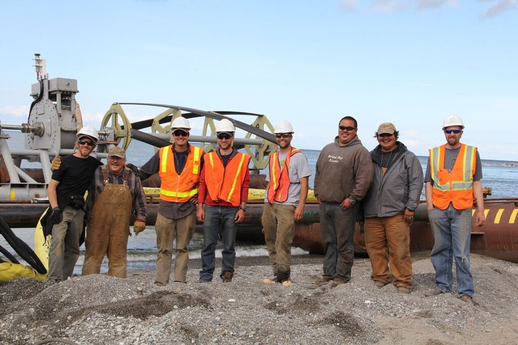 Local contractors and ORPC team members in front of RivGen (Photo courtesy of ORPC)
