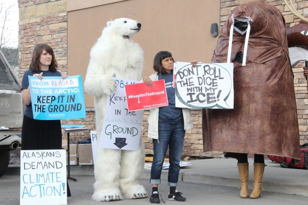 Frostpaw the Polar Bear joined protesters outside BOEM's meeting in Anchorage on April 5, 2016. The protesters argue that BOEM has not taken climate change into account when considering offshore leases. Photo: Rachel Waldholz/APRN