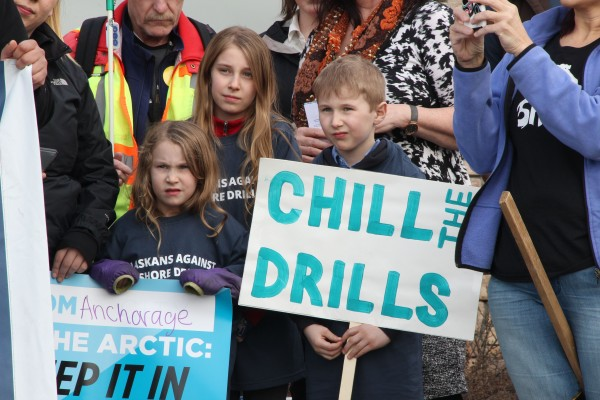 Molly, Penelope and Simon Whitlock, ages 5, 10 and 7, joined protesters opposed to offshore drilling outside the Bureau of Ocean Energy Management's public meeting in Anchorage on April 5, 2016. Photo: Rachel Waldholz/APRN