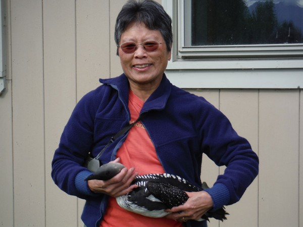 Jean Tam with a banded loon