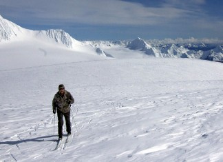 Chris Hanna, of Soldotna, skis on the Harding Icefield on Friday, April 8, 2016, with the Kenai Fjords and mountains surrounding Seward, on the Kenai Peninsula, in the background. (Photo courtesy of Jenny Neyman)