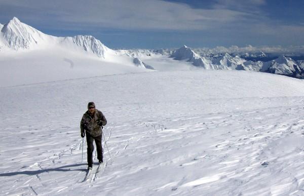 Chris Hanna, of Soldotna, skis on the Harding Icefield on Friday, April 8, 2016, with the Kenai Fjords and mountains surrounding Seward, on the Kenai Peninsula, in the background. (Photo courtesy of Jenny Neyman)