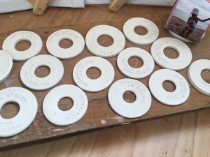 The medals, dry and ready for glaze. Photo credit: Becky King