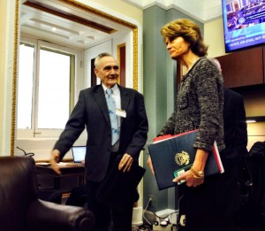 Aleutians East Borough Mayor Stanley Mack and Sen. Lisa Murkowski prepare to meet with reporters at the Senate Press Gallery. Photo: Liz Ruskin/APRN