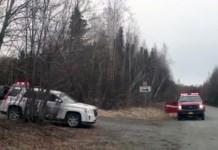 Emergency vehicles near the scene of a plane crash in Birchwood on April 20, 2016. (Photo by Ellen Lockyer/Alaska Public Media)