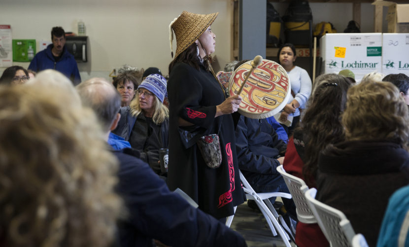 Nancy Barnes sings during a groundbreaking ceremony for a homeless housing facility on Monday May 16, 2016 in Juneau, Alaska. The Juneau Housing First Collaborative is overseeing the project which will put a 32-unit facility in place. Barnes and others in a multicultural Yees Ku Oo dance group performed on the construction site as part of the celebration. (Photo by Rashah McChesney, KTOO - Juneau)