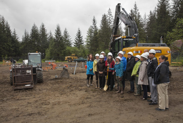 Representatives from several agencies working to bring a Housing First project to fruition pose for a photograph during a groundbreaking ceremony on Monday May 16, 2016 to celebrate the construction of the facility in Juneau, Alaska. The Juneau Housing First Collaborative is overseeing the project which will put a 32-unit facility in place. (Photo by Rashah McChesney, KTOO - Juneau)