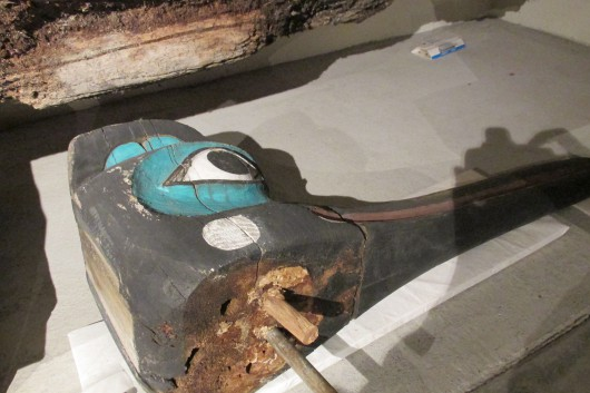 A large fragment from the Chief Kyan Totem Pole showing a metal rod repair. (Photo by Maria Dudzak, KRBD - Ketchikan)