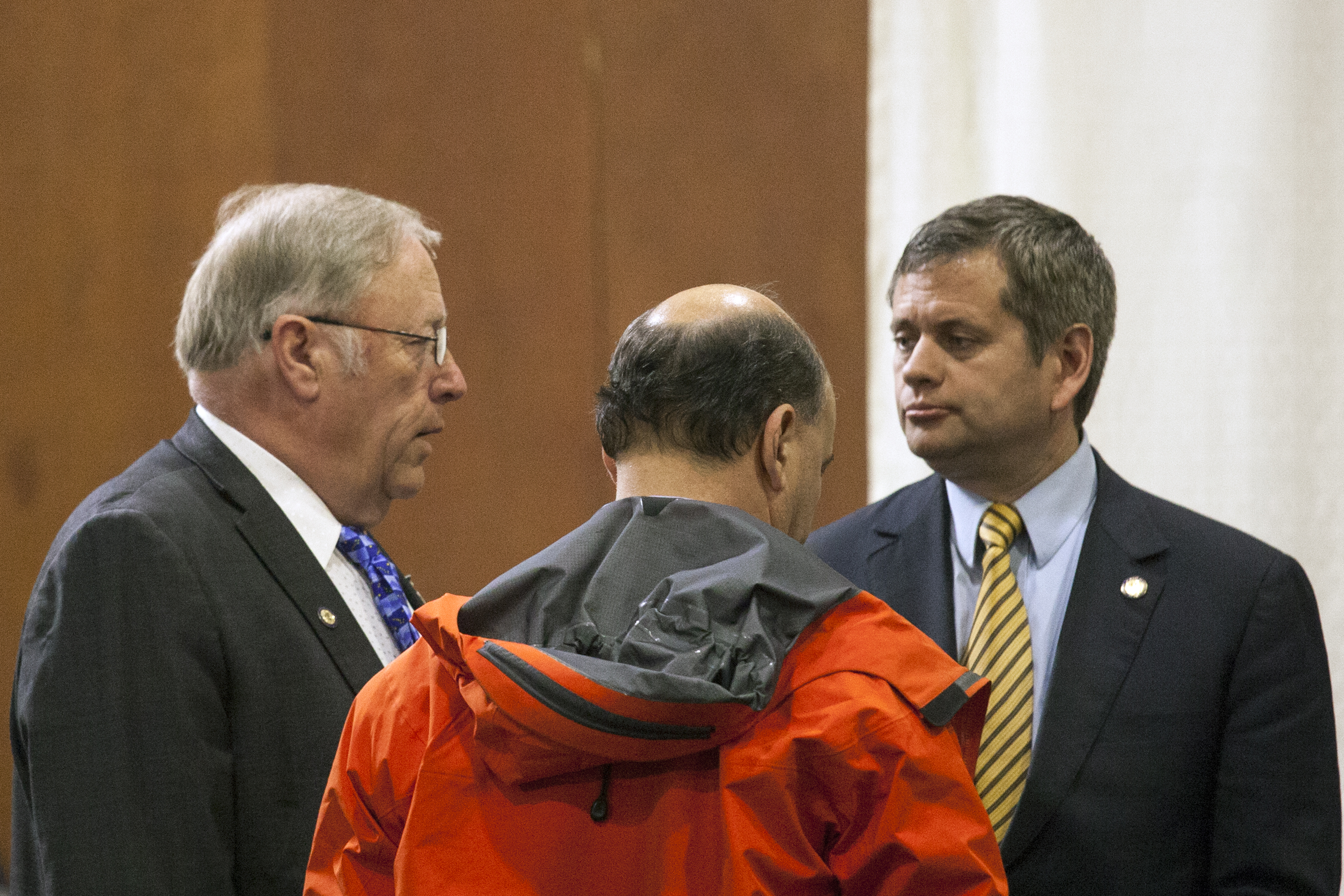 House Speaker Mike Chenault, R-Nikiski, Rep. Les Gara, D-Anchorage and House Minority Leader Chris Tuck, D-Anchorage, confer after the first floor session of the legislature's special session on Monday May 23, 2016 in Juneau, Alaska. (Photo by Rashah McChesney, KTOO - Juneau)