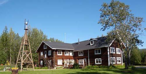 Rika's Landing, a restored roadhouse, serves as the Big Delta State Historical Park's main attraction. State Parks shored-up about 300 feet of the Tanana River's south bank 10 years ago to halt erosion that could eventually have threatened Rika's. (Photo courtesy of Alaska Department of Natural Resources)