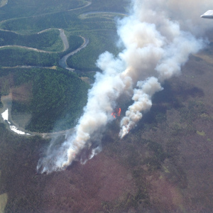 A photo taken Sunday of the Medfra Fire burning about 50 miles northeast of McGrath along the north bank of the North Fork Kuskokwin River. (Photo by Jason Jordet/Alaska Division of Forestry)