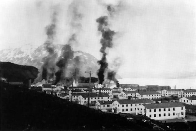 Buildings burning after the first Japanese attack on Dutch Harbor, Alaska (USA), 3 June 1942. (Photo courtesy of the U.S. Army)