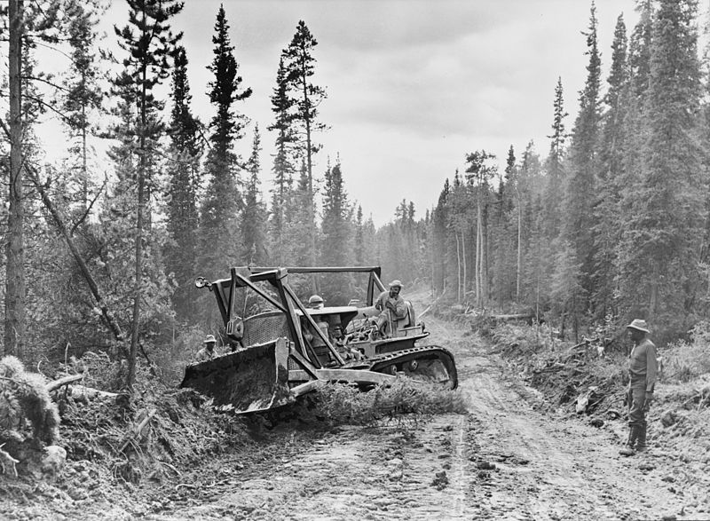 Caterpillar tractor with grader widening the roadway of the Alcan Highway in 1942 (File photo courtesy of the Library of Congress)
