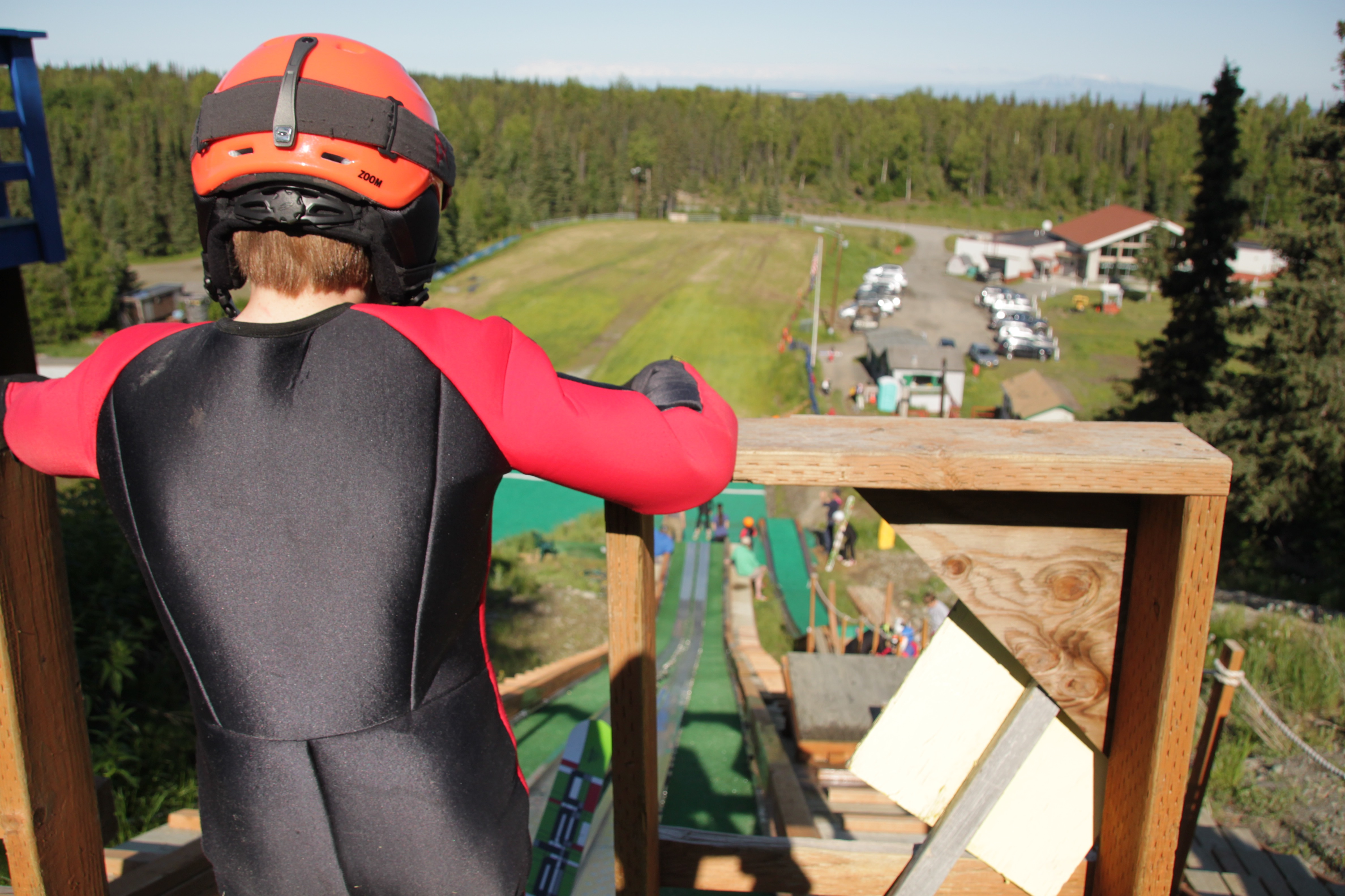 One of the skiers looks out at the ski jump facility from the top of the 40-meter hill. (Photo by Ammon Swenson, Alaska Public Media - Anchorage)