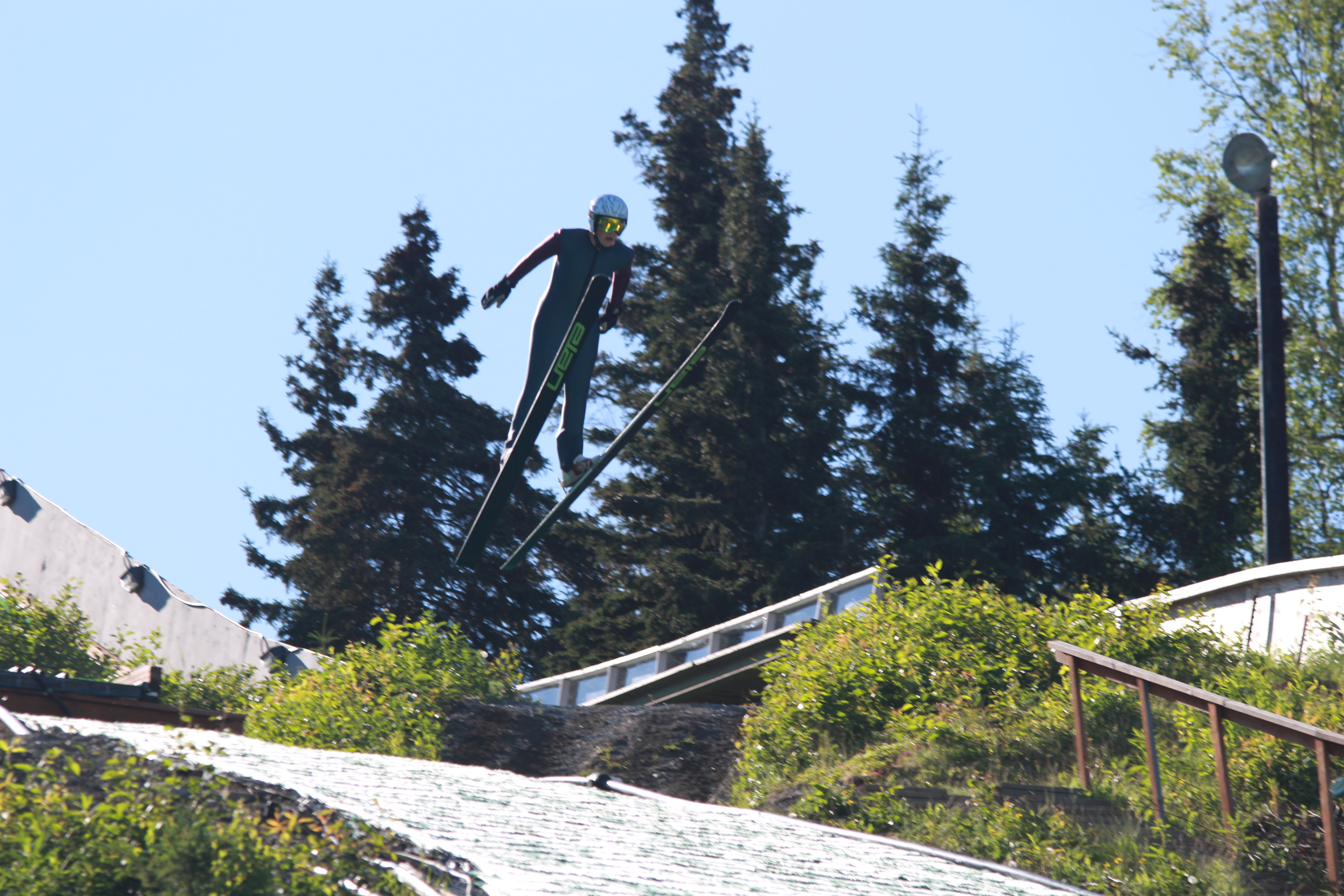 One of the skiers flies off the 40 meter ski jump. (Photo by Wesley Early, Alaska Public Media - Anchorage)