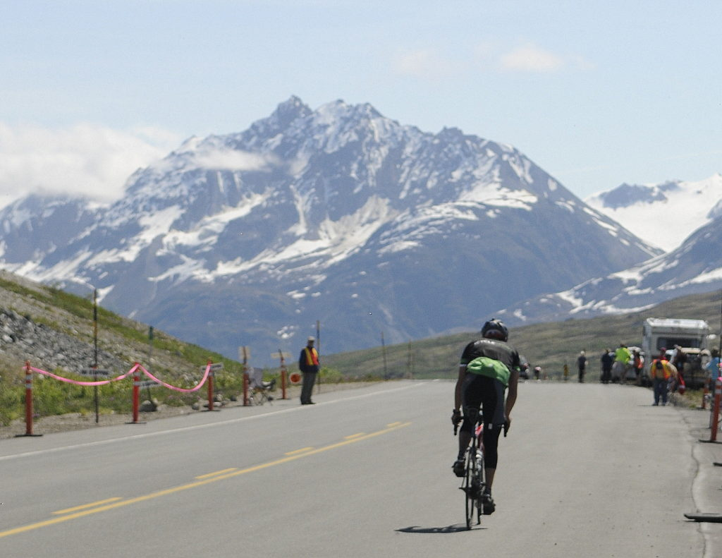 A solo rider crests the summit during Saturday's Kluane-Chilkat International Bike Relay. (Photo by Jillian Rogers - KHNS - Haines)