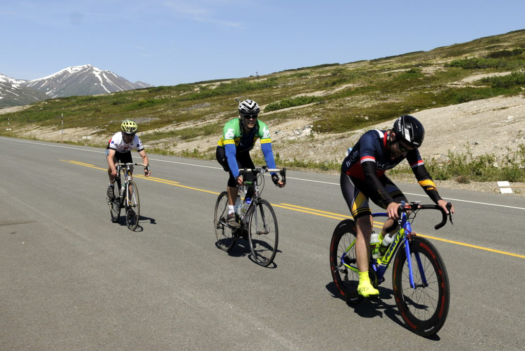 A pack of riders make their way past the summit checkpoint during Saturday's Kluane-Chilkat International Bike Relay. (Photo by Jillian Rogers, KHNS -Haines)