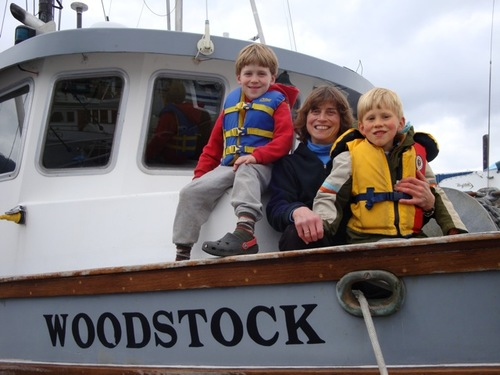 Linda Behnken with her sons, Rio and Hahlen. Behnken lives the small-boat fishing life she advocates for, but she's no stranger to IPHC politics. She's chaired the 84-member IPHC Conference Board for the last several years. (ALFA photo by Mim McConnell)