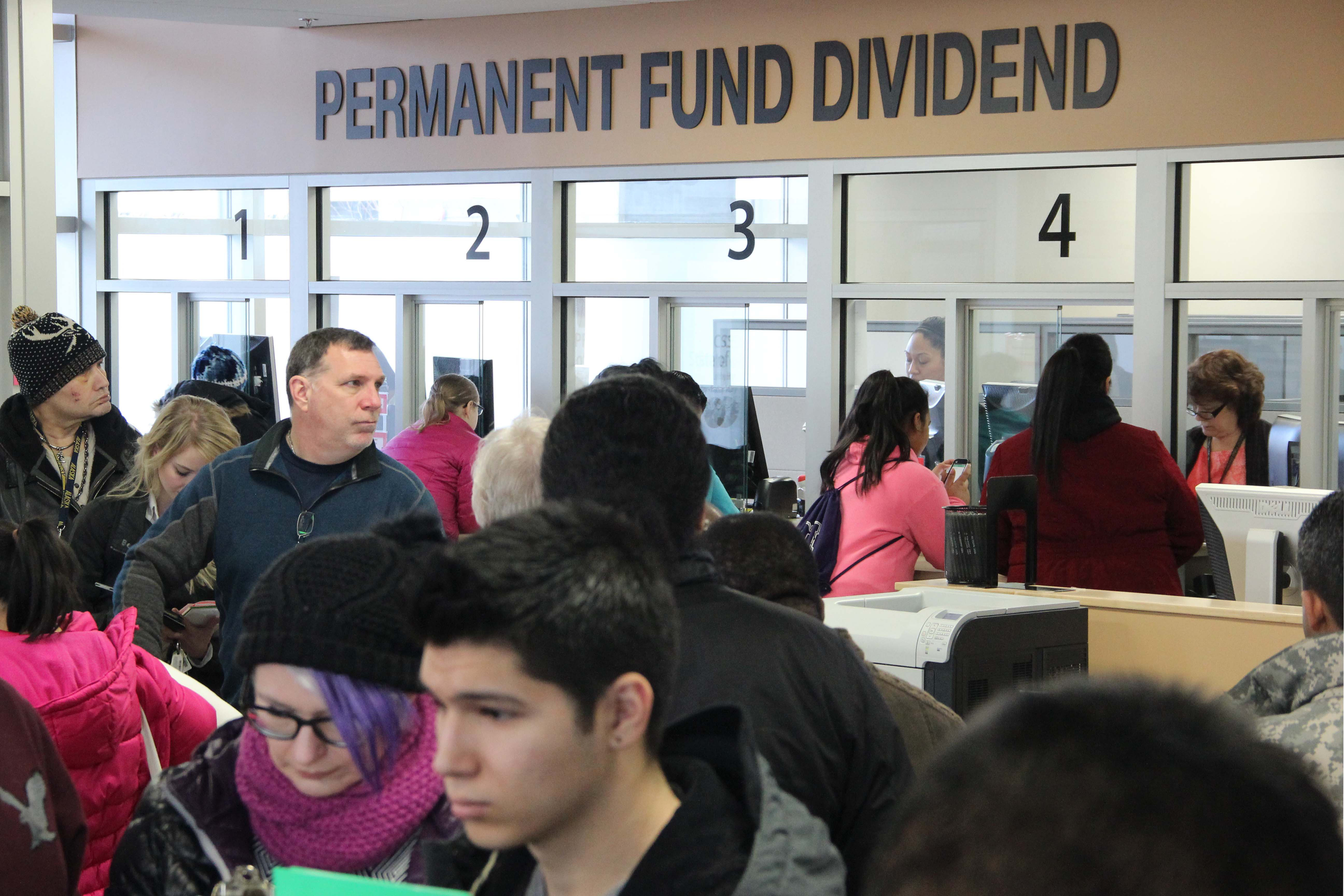 Alaskans wait in line to file their Permanent Fund dividend applications in downtown Anchorage in March 2016. Photo: Rachel Waldholz, APRN