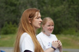 Alexis Lochner (left) and Jenna Baldiviez address the crowd at Anchorage's Run/Walk for Epilepsy on Saturday, June 4. (Photo by Graelyn Brashear, Alaska Public Media - Anchorage)