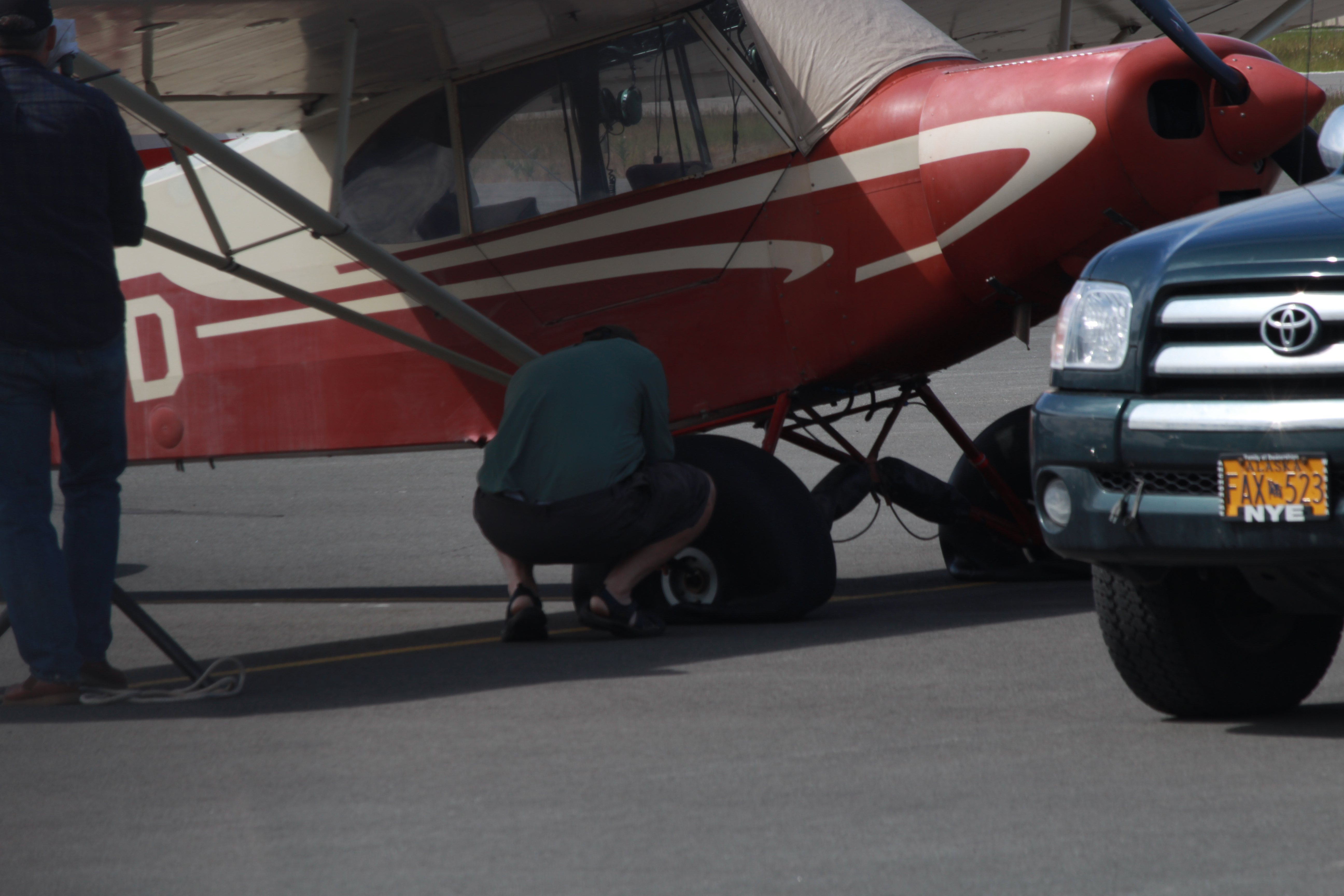 One of the victims of the tire slashings repairs his plane at Merrill Field (Photo by Wesley Early, Alaska Public Media - Anchorage)