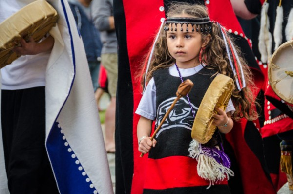 A young drummer at the grand entrance to Celebration 2014. (Photo by Heather Bryant/KTOO)