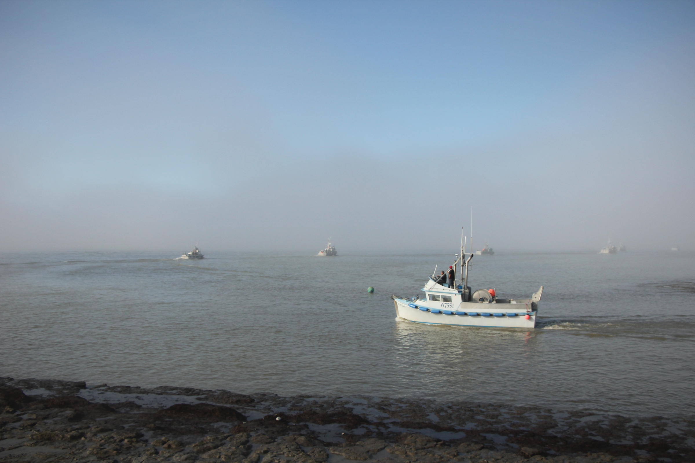 Boats leave Dillingham to fish the Nushagak District in June 2016. The story of Bristol Bay's harvesters and fishing communities will be key to the new Bristol Bay sockeye branding effort, which will launch in Boulder this fall. (Photo by Cate Gomez, KDLG - Dillingham)