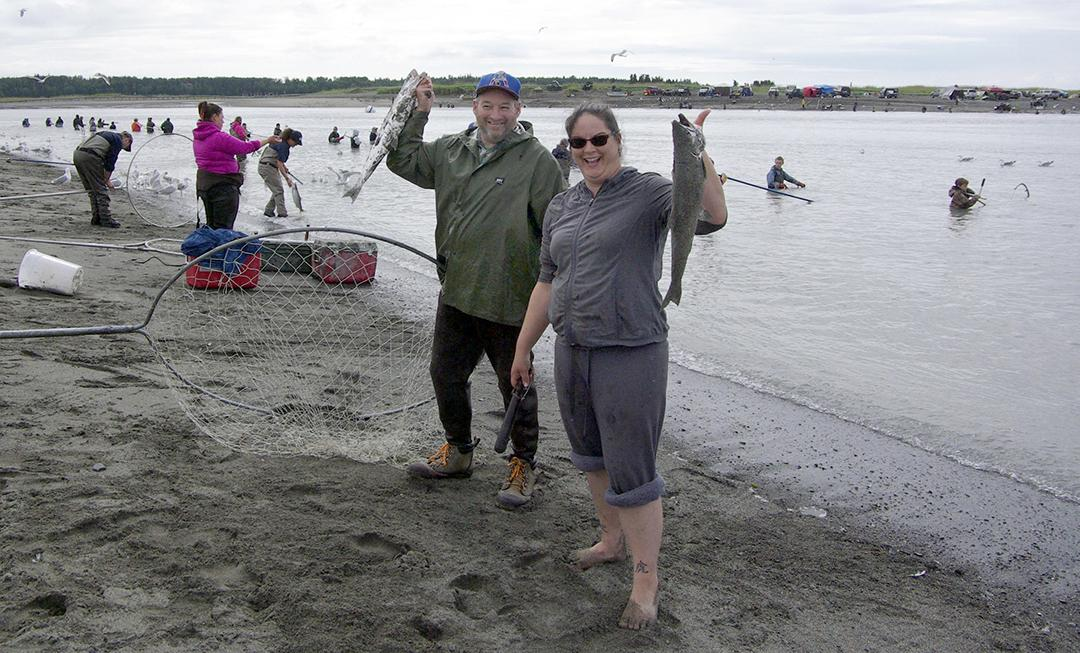 John Wentworth and Tracy Christal drove down from Talkeetna to participate in the Kasilof River personal-use dip net fishery last week. Though they live on the Big Su, Wentworth said the fish are better fresh from the ocean. (Photo by Jenny Neyman, KBBI - Homer)