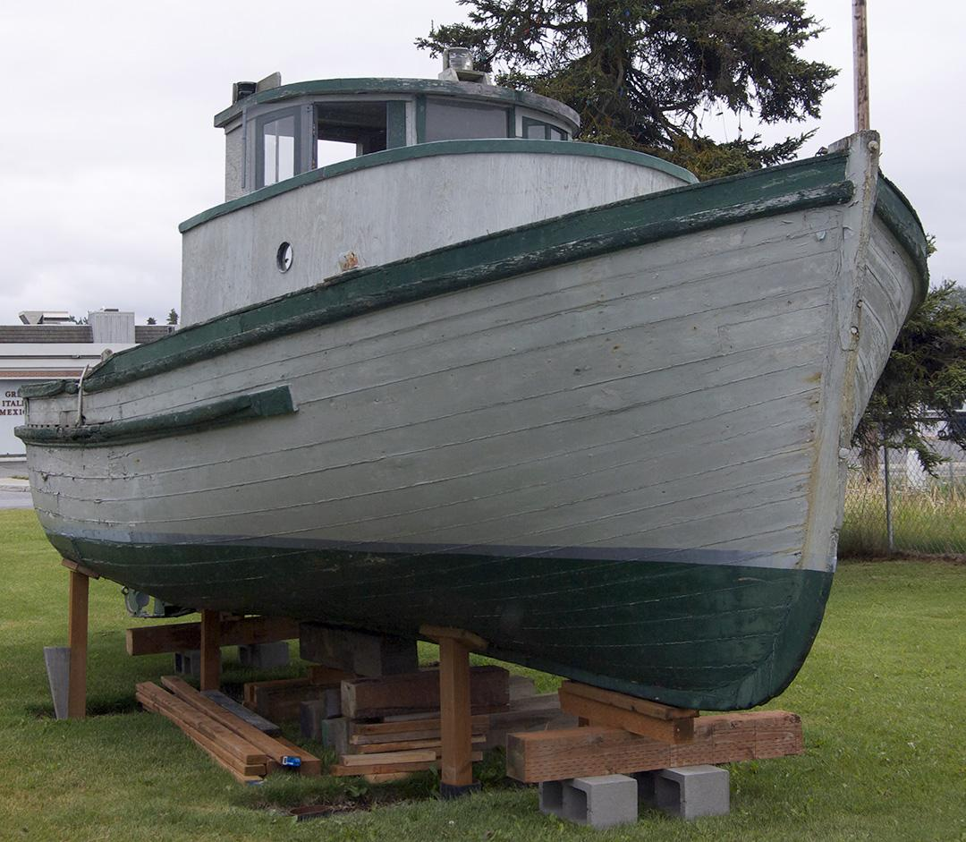 A Bristol Bay double-ender fishing boat is on display at the Kenai Historical Society's office, across the parking lot from the Kenai Visitors and Cultural Center. (Photo by Jenny Neyman, KBBI - Homer)