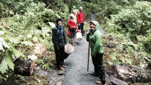 A Trail Mix volunteer crew adds gravel to a muddy part of Juneau's Lemon Creek Trail on National Trails Day, June 4. The trail crosses city and Forest Service land. (Photo courtesy Trail Mix)