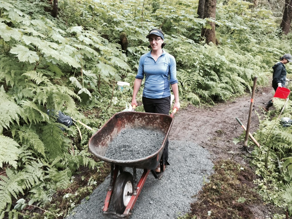 A Trail Mix volunteer moves gravel to a muddy part of Juneau's Lemon Creek Trail. A new agreement means the nonprofit group will expand its work in Alaska's national forests. (Photo courtesy Trail Mix)