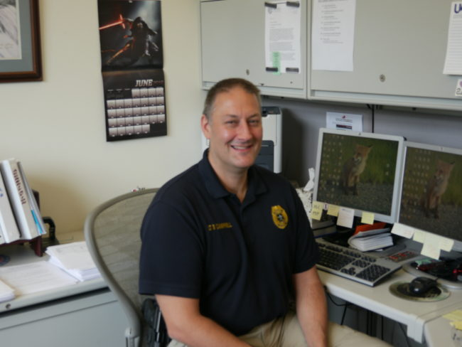 Juneau police Lt. David Campbell at his desk. (Photo by Quinton Chandler, KTOO - Juneau)