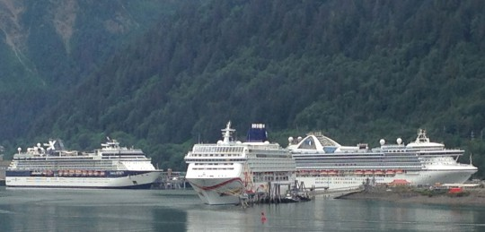 Three cruise ships dock in downtown Juneau July 14, at the height of the tourist season. (Photo by Ed Schoenfeld, CoastAlaska News)