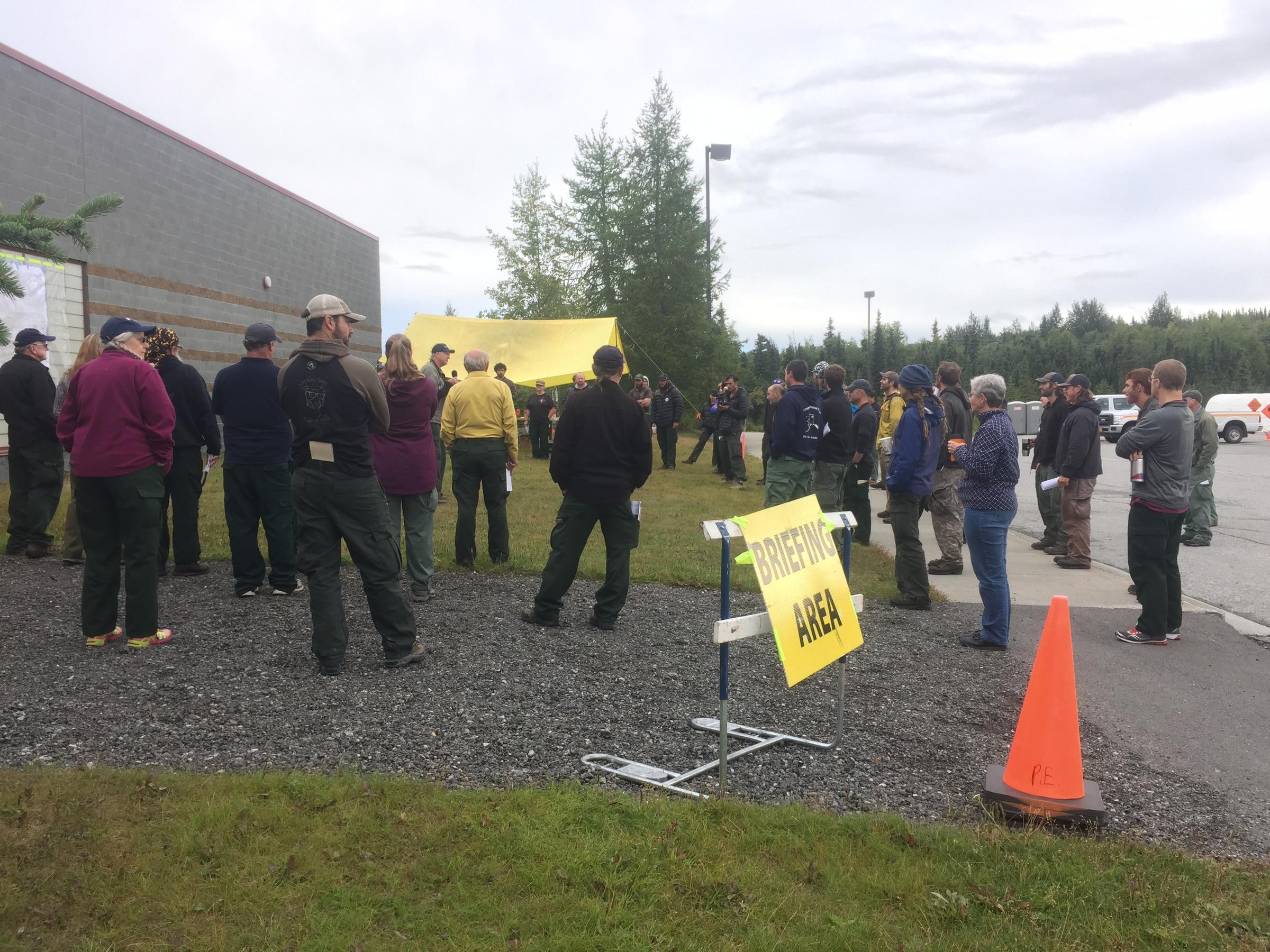 Fire responders at the McHugh fire daily briefing Tuesday morning. Alaska's Chena, Tanana Chiefs Conference and White Mountain firefighter crews are mopping up hot spots. (Photo by  Joaqlin Estus, KNBA - Anchorage)