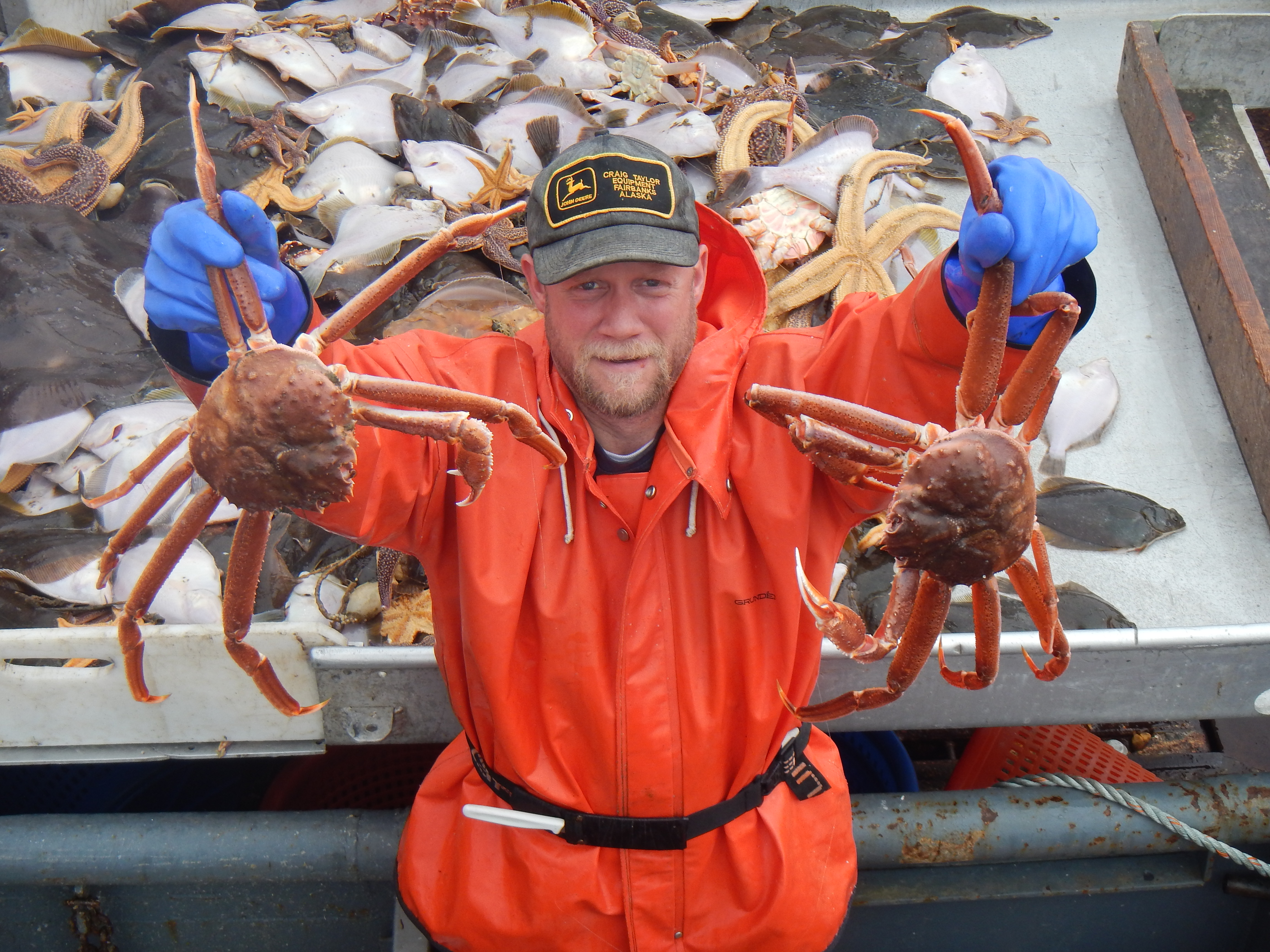 Bob Foy, director of the NOAA lab in Kodiak, holds up king crab, a species expected to be impacted by ocean acidification. (Photo courtesy NOAA's Fisheries Science Center)