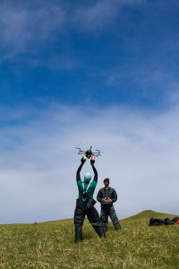 Holding a hexacopter (or drone) before it takes flight. (Courtesy Kristen Campbell, NOAA Fisheries)