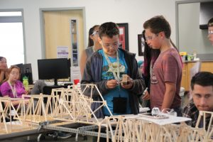 Students prepare to test their bridges at the ANSEP Middle School Academy. (Photo by Ammon Swenson, Alaska Public Media- Anchorage)